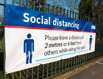 Free Large Social Distancing Banner Attached To Railing At Entrance To Public Park. Royalty Free Stock Image - 178867676