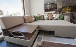 Large sofa in furniture showroom Stock Image