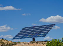 Large solar panel on a hill. Large photovoltaic solar panel against blue sky Stock Photography