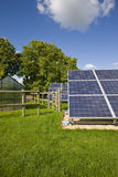 Large solar panels underneath blue sky Royalty Free Stock Images