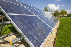 Large solar panels underneath blue sky Royalty Free Stock Image