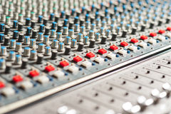 Large sound mixer equipment in studio. Closeup shot of audio mixer in recording studio Royalty Free Stock Photo