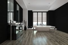 Large spacious black and white bathroom interior. With a freestanding bathtub and wall mounted vanities and mirror, view down the length of the parquet floor Royalty Free Stock Images