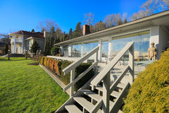 Large spacious deck of grey waterfront home Stock Photography