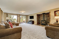 Large and spacious living room, brick wall with fireplace Stock Photography
