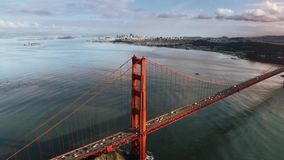 Large spectacular red steel Golden Gate bridge in San Francisco wild nature mountain hill aerial drone seascape skyline. Large spectacular red steel Golden Gate stock video footage