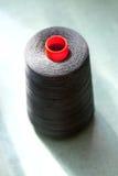 Large Spool of Black Thread on Table Stock Photos