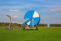 A large spools of irrigation pipes on field Royalty Free Stock Photography