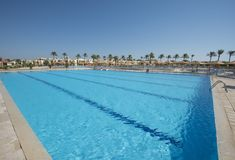 Large sports swimming pool in a luxury tropical hotel resort Royalty Free Stock Images