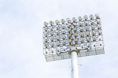 Large spotlights at the outdoor stadium under the blue sky royalty free stock image
