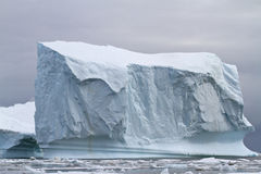 Large square iceberg in the Antarctic winter Royalty Free Stock Image