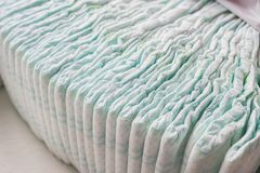 A large stack of baby diapers, close-ups, diaper packaging royalty free stock photography