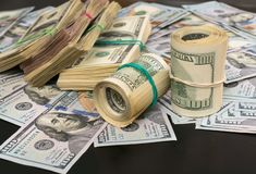 Large stack of cash with stacks of 100 USD bills royalty free stock photography