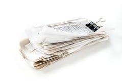 Large stack of checks. Sealed Binder Clip Stock Images