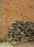 Large stack of cobbles in front of a brick wall Stock Images