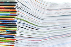 A large stack of colorful magazines. Close-up Stock Image