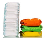 Large stack of disposable diapers reusable corresponds to several on white. A large stack of disposable diapers reusable corresponds to several on white royalty free stock images