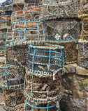 A Large Stack of Multicolored Crab Pots Stock Photo