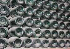 Large stack of wine bottles in winery Stock Images