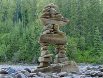 Large stacked stones Inuksuk cairn trail marker Royalty Free Stock Photos