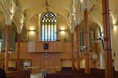 Church Chorus Balcony. Large stained glass window back lights chorus balcony Royalty Free Stock Photography