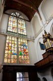 Large stained glass window and a tube organ Stock Image