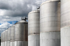 Large stainless steel fermentation vessel under cloudy sky Royalty Free Stock Photography