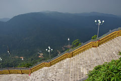 Large stairways in the middle of hilly mountainous jungle Royalty Free Stock Image