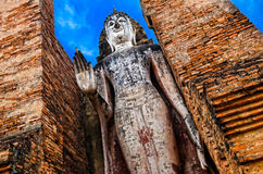 Large standing stone Buddha in Sukhothai historical park, Thaila Stock Photo