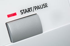 A large start or pause button. A start or pause button with a red indicator light. Macro image stock images