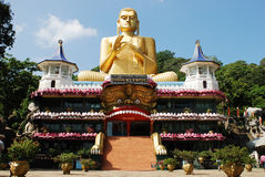 Large statue of Buddha at the entrance to a Buddhi Stock Image