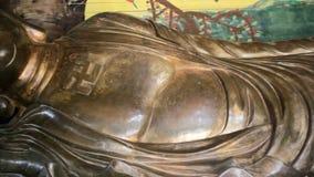 Large Statue of Golden Buddha Van Hanh Pagoda, Dalat, Vietnam, panning camera tracking shot, High quality in HD stock video footage