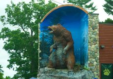Large statue of grizzly bear. Michigan, United States - July 17, 2017: A large statue of a grizzly bear stands above Traverse City Bear Company, a local retail royalty free stock photography