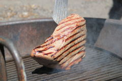 Large steak on the BBQ grill Royalty Free Stock Images