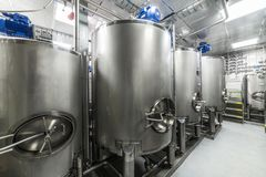 Large steel mixing tanks, modern production of spirits. Food industry stock photo