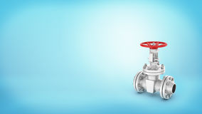 A large steel stop valve with a red wheel handle attached to a pipe on blue background. Stock Photos