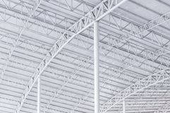 Large steel structure truss, roof frame and metal sheet in building Stock Images
