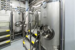 Large steel tanks for mixing liquids, modern production of alcoholic beverages. Food industry royalty free stock photography
