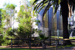 Large steel wine vats among palm trees at Seppeltsfield Royalty Free Stock Images