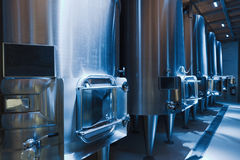 Large stell barrels in winemaker factory Stock Photos