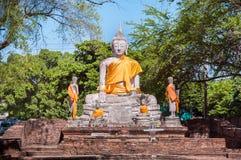 Large stone Buddha statue with orange sash, Ayutthaya, Thailand Royalty Free Stock Image