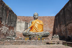 Large stone Buddha statue at the partially restored ruin of Wat Worachet Tharam in the ancient city of Ayutthaya, Thailand Royalty Free Stock Image