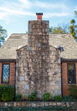 Large Stone Chimney on Small Brick Cottage Stock Photography