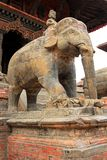 A large stone elephant guarding the Shiva Temple Stock Image