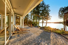 Large stone floor patio area of waterfront house royalty free stock photo