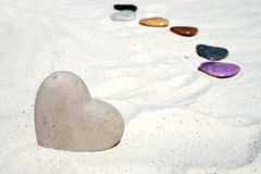 Large stone heart in the sand Stock Images