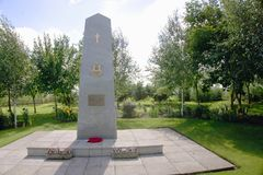 Burma Star Memorial. A large stone obelisk with a cross, Burma star and inscription on a plaque. This is at the National memorial arboretum Staffordshire UK Royalty Free Stock Image
