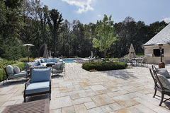 Large stone patio with swimming pool Royalty Free Stock Photos