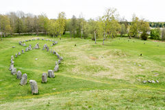 Large stone ship. Made of raised stones in Anundshog, Sweden. Also seen are burial mounds in the field Stock Photo
