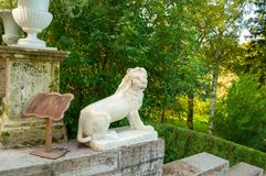 Large stone staircase and sculpture of a lion on a pedestal in Pavlovsk park, St Petersburg, Russia Stock Photos